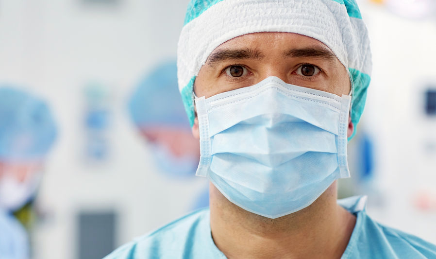 Man wearing mask and scrubs
