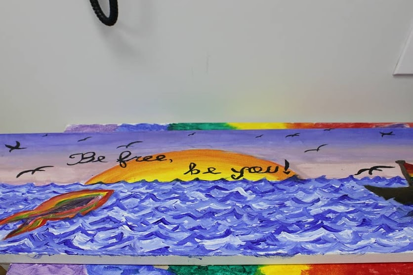 art painting of ocean by homeless youth