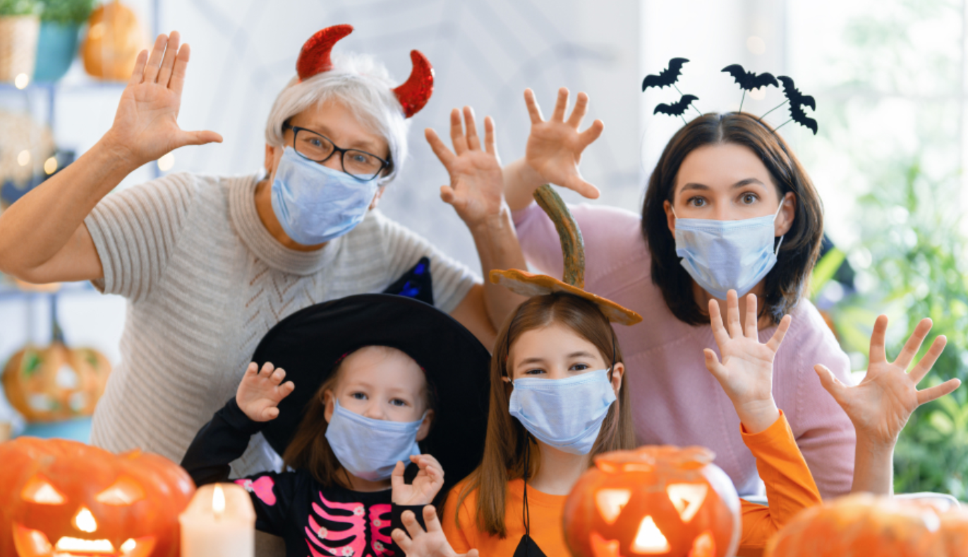 Family wearing a face masks with jack o lanterns