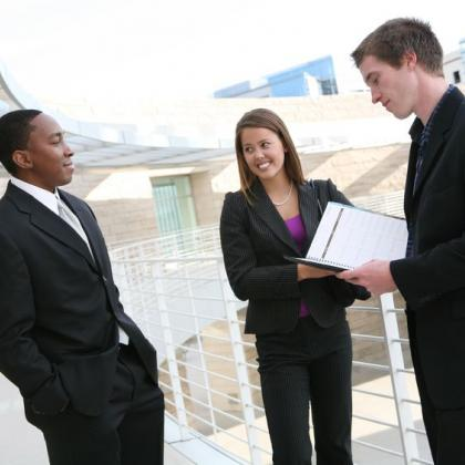 three young job seekers standing on a balcony
