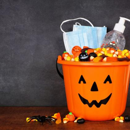 Halloween Jack-o-lantern Bucket with candy corn, face masks, and hand sanitizer