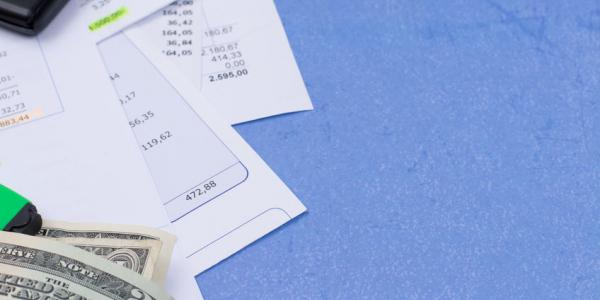 Image of bills and money on blue background