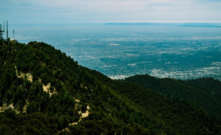 Image of Mt. Wilson with trees and blue sky with clouds